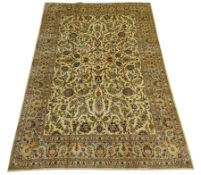 Persian Kashan rug carpet, ivory ground decorated with interlacing scrolled foliage and stylised flo