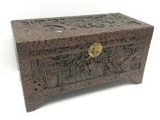 Eastern carved camphor wood blanket box depicting village scene, W94cm, H49cm, D45cm