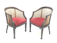 Pair Early 20th century Georgian style mahogany bergere armchairs, square tapering supports carved w