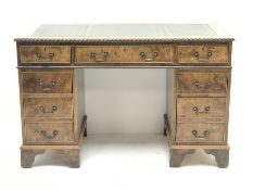 Late 20th century elm twin pedestal desk, rectangular moulded top with green leather inset, fitted w