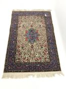 Persian beige ground rug carpet, central medallion with floral field and border, 185cm x 125cm