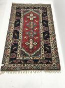 Persian style beige ground rug, field of four medallions, 237cm x 149cm
