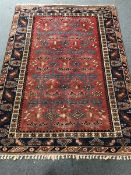 Turkish red and blue ground rug, geometric patterned field, repeating border, 272cm x 202cm