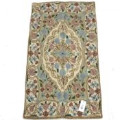 Crewel work beige ground wool chain rug, central medallion, 88cm x 50cm