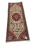 Persian red ground runner, central medallion, 195cm x 76cm