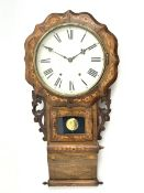 19th century drop dial wall clock, shaped front with circular Roman dial, leaf carved and pierced br