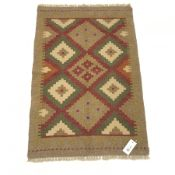 Hand stitched tan ground wool chain rug, 90cm x 60cm
