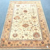Keshan beige ground rug, repeating border, 300cm x 200cm