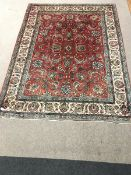 Persian Tabriz red ground carpet, central medallion, repeating border, 355cm x 270cm