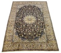 Persian Nain carpet, floral design on dark blue field, central rosette medallion, ivory ground outer