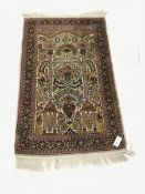 Small Persian beige ground silk rug, repeating border, 124cm x 79cm
