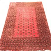 Bokhara red ground rug, repeating border, patterned field, 290cm x 202cm