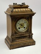 Late 19th century oak cased mantel clock, gadroon carved stepped pediment, circular dial with Arabic