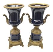 Pair of 19th century style cobalt blue twin-handled Campana urns, with bronzed mounts, raised upon f