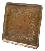Herbert Dyer (1898-1974), an Arts and Crafts hammered copper tray, of square form decorated with fis