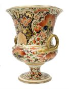 Early 19th century Derby campagna vase, with twin gilt serpent modelled handles and raised upon a sp