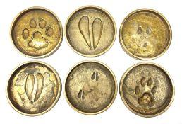 Rowland Ward (British Taxidermist: 1848�1912), set of six African Animal brass paw print coasters, c