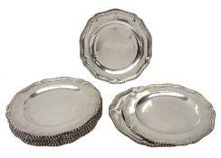 Set of twelve George III silver dinner plates by Thomas Heming, London 1769, each circular shaped wi