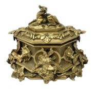 Late 19th century gilt bronze casket, of lozenge form with cast and applied detail in the form of ho