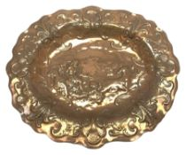Large Newlyn School oval copper wall plaque, the dished centre embossed with a study of Neptune ridi
