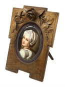 19th century KPM style oval porcelain plaque, painted with a portrait of Beatrice Cenci after Guido