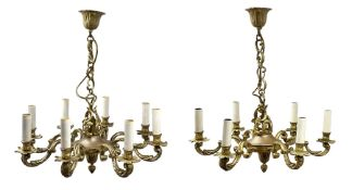 Two gilt bronze chandeliers, in the 18th century taste, the first with eight scrolling branches lead