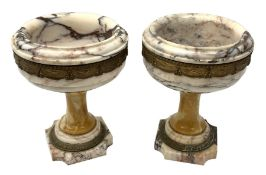 Pair of Neo Classical veined white marble urns, decorated with a metal band of classical drapes, rai