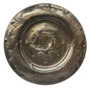 Large copper Arts and Crafts charger, possibly Newlyn, of circular form, repouss� decorated with a g
