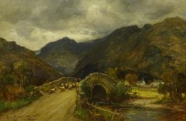 Owen Bowen (Staithes Group 1873-1967): Sheep crossing a Stone Bridge in the Lake District, oil on ca