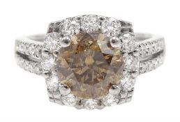 18ct white gold round brilliant cut fancy light brown diamond ring, with halo diamond surround and d