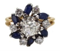 18ct gold diamond and sapphire ring, the central old cut diamond of approx 0.75 carat, with round br
