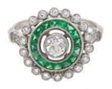 Platinum round diamond and calibre cut emerald target design ring, with diamond set shoulders