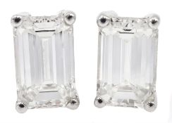 Pair of 18ct white gold emerald cut diamond stud earrings, hallmarked, total diamond weight 1.80 car