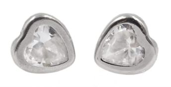 Pair of white gold cubic zirconia heart stud earrings, stamped 9K