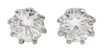 Pair of 18ct white gold round brilliant cut diamond stud earrings, total diamond weight approx 0.80