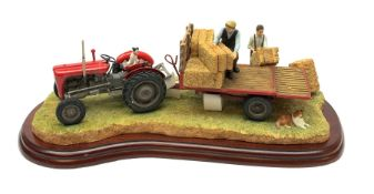 A Border Fine Arts figure group, Loading Up, model no A3448 by Ray Ayres, on wooden base, figure L32