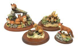 Four Border Fine Arts figures, comprising Secret Places, Model no A0400, Rocky Den (Fox Family), on
