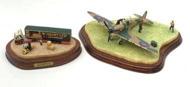 Two Border Fine Arts figurines, comprising Eddie Stobart LTD loading scene, on wooden base, and Scra