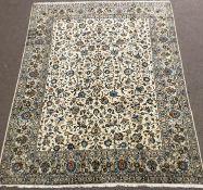 Large Kashan ivory ground rug, repeating border, blue trailing foliage, central medallion, 405cm x 3
