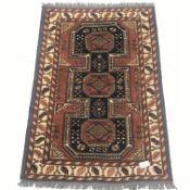 Turkish style beige ground rug, repeating border, 145cm x 104cm