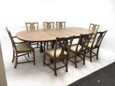 19th century style extending oak dining table, two leaves, baluster supports joined by shaped stretc