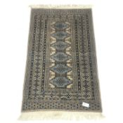 Persian style beige ground rug, repeating borer, 140cm x 87cm