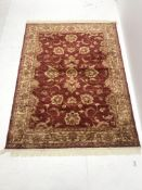 Persian red ground rug, central medallion, 187cm x 140cm