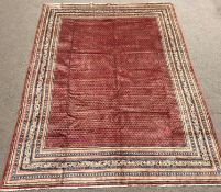 Large Persian Araak red ground rug, multiple band border, repeating boteh motifs field, 392cm x 284c
