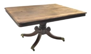 Regency mahogany breakfast table, rectangular moulded tilt top with rounded corners, turned and carv