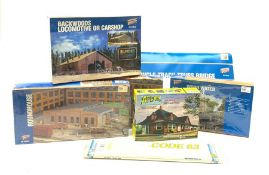 HO scale - four unopened Cornerstone construction kits comprising two Roundhouses, Backwoods Locomot