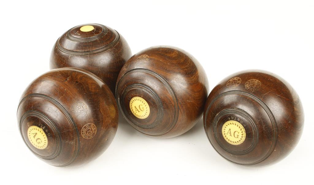 Lot 45 - A set of four lignum bowls marked A.G.
