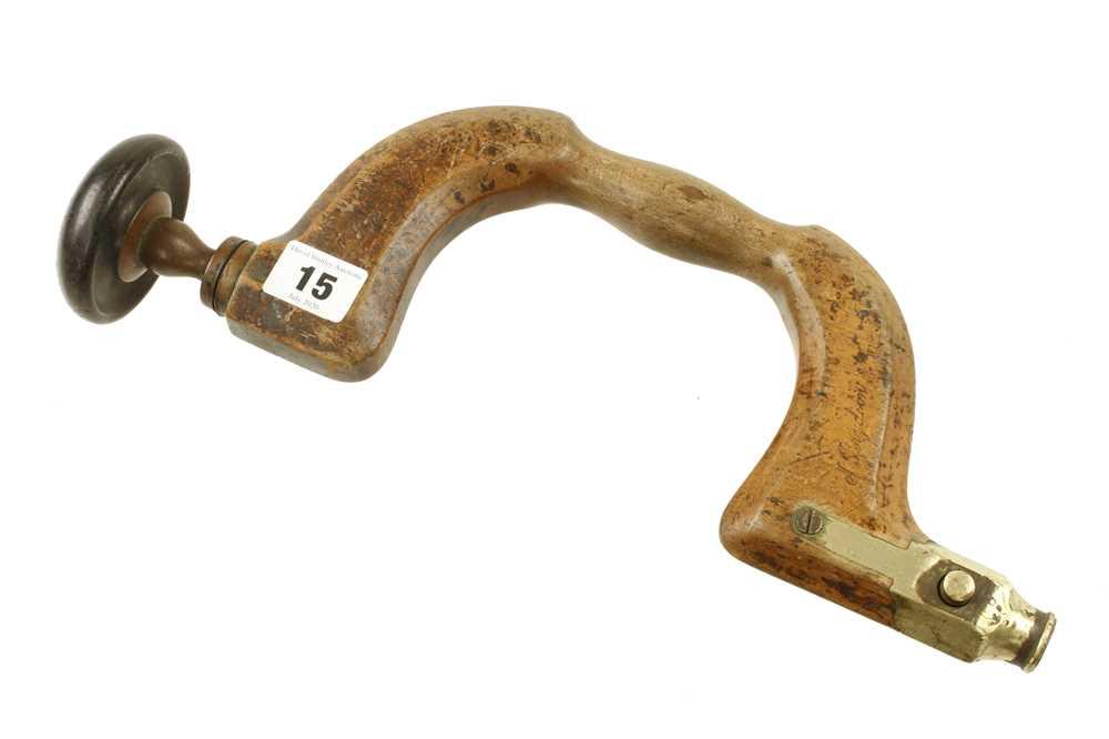 Lot 15 - A brass button pad beech brace by MATHIESON G