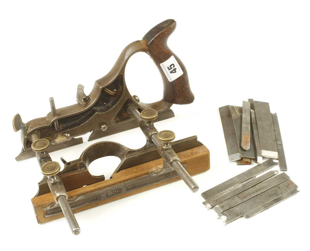 Lot 45 - A SIEGLEY combination plane marked No 2 on fence with cutters, one screw missing G