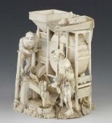 """A most unusual 7"""" ivory okimono of a group of industrious farmers winnowing rice with birds atop"""